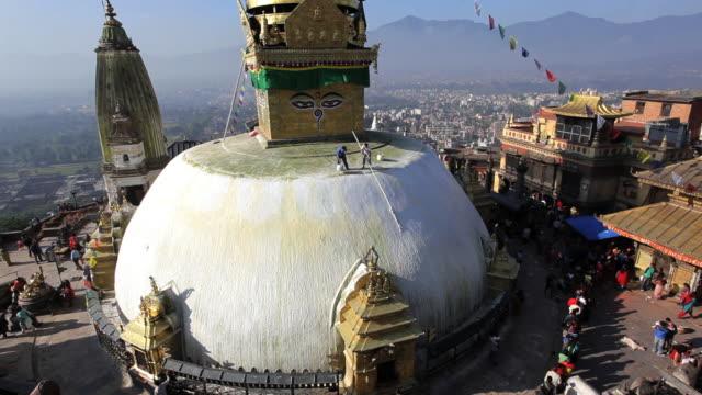 swayambhunath stupa or monkey temple being painted a place of worship, kathmandu, nepal, asia  - place of worship stock videos & royalty-free footage