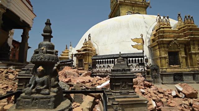 kathmandu, nepal - may 1, 2015: swayambhunath (monkey temple) stupawhich was severly damaged after the major earthquake - nepal stock videos & royalty-free footage