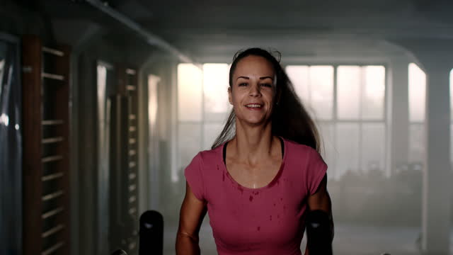 slo mo sweaty young woman running on a treadmill - treadmill stock videos & royalty-free footage