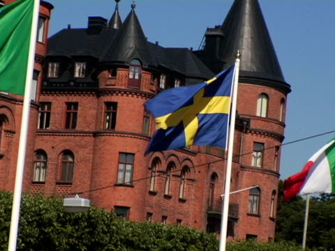 ms, zi, cu, sweden, stockholm, swedish flag in front of brick buildings - swedish flag stock videos and b-roll footage
