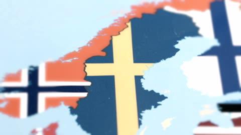sverige med flagga på världskartan - kartografi bildbanksvideor och videomaterial från bakom kulisserna