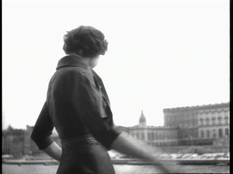 swedish actress ingrid bergman looks out over a river in her hometown of stockholm, sweden. she then glances around near the camera. mcu bergman... - music or celebrities or fashion or film industry or film premiere or youth culture or novelty item or vacations stock videos & royalty-free footage