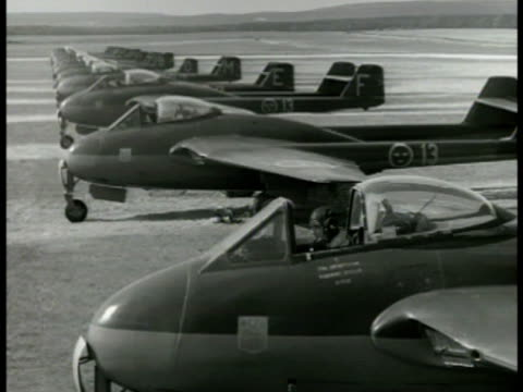 stockvideo's en b-roll-footage met swedish air force pilots climbing into row of jet airplanes lined up on field ms airplane taxiing ws fighter airplane taking off from strip - 1949