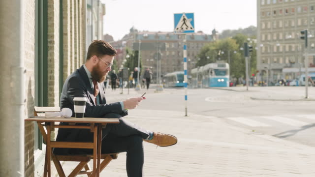 a swedish businessman is taking a break at a cafe - completo video stock e b–roll