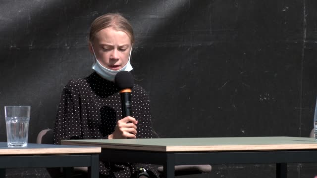 swedish climate activist greta thunberg attends a press conference after the meeting with german chancellor angela merkel on august 20 2020 in berlin... - climate activist stock videos & royalty-free footage
