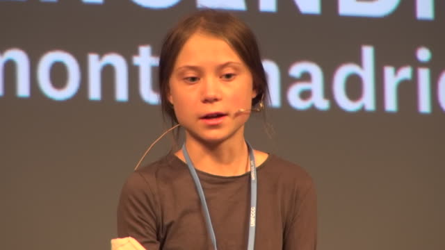 swedish climate activist greta thunberg speaks to assistants during a 'fridays for future' press conference at la casa encendida in madrid on... - other stock videos & royalty-free footage