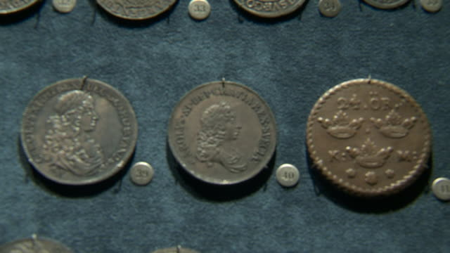 Swedish coins on display at the Royal Coin Cabinet in Stockholm Sweden in October 7 Pans and close ups of Swedish coins on display Wide shots and...