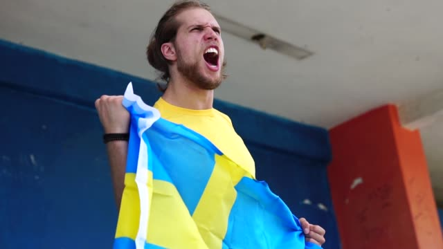 swedish fan watching a soccer game - fan enthusiast stock videos & royalty-free footage
