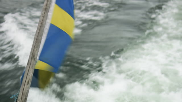 a swedish flag on a boat stockholm archipelago sweden. - swedish flag stock videos and b-roll footage