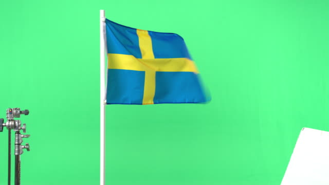 swedish flag on green screen - swedish flag stock videos and b-roll footage