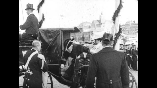 swedish king gustav v and queen arrive in horse-drawn carriage, disembark, pass through receiving line prior to warship launch. - 1910 stock videos & royalty-free footage
