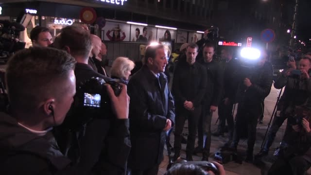 Swedish Prime Minister Stefan Lofven lays flowers where the driver of a stolen truck ploughed into a crowd outside a busy department store in central...