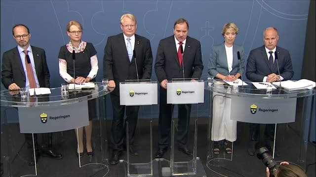 Swedish Prime Minister Stefan Lofven speaks at a press conference next to Swedish Minister for Infrastructure Tomas Eneroth Minister for Migration...