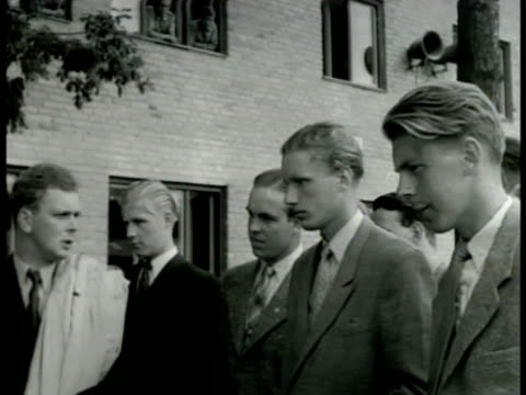 stockvideo's en b-roll-footage met swedish soldier leading recruits walking ms recruits waiting ms recruits signing up at table la ms recruits learning practicing rifle drills - 1949