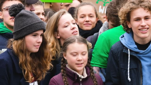 swedish teenaged climate activist greta thunberg participates in a fridays for future march with german climate activists luisa neubauer and jakob... - klima stock-videos und b-roll-filmmaterial