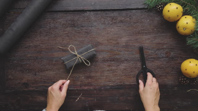 swedish woman wrapping christmas presents - rustic stock videos & royalty-free footage