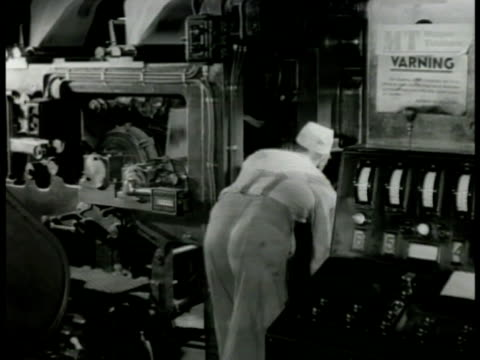 stockvideo's en b-roll-footage met swedish worker operating printing press machine ms workers stacking bundles of newspapers ext ms man reading newspaper on bench - 1949