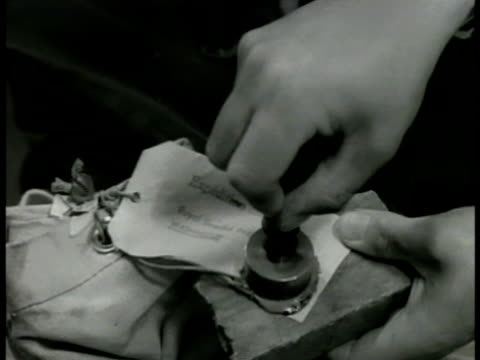 stockvideo's en b-roll-footage met swedish workers in mail department cu stamping wax seal ext ms russian embassy ms us embassy int vs people entering reception being greeted by... - 1949