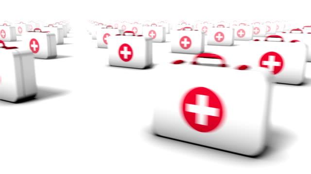 sweeping across endless first aid kits front - första hjälpen sats bildbanksvideor och videomaterial från bakom kulisserna