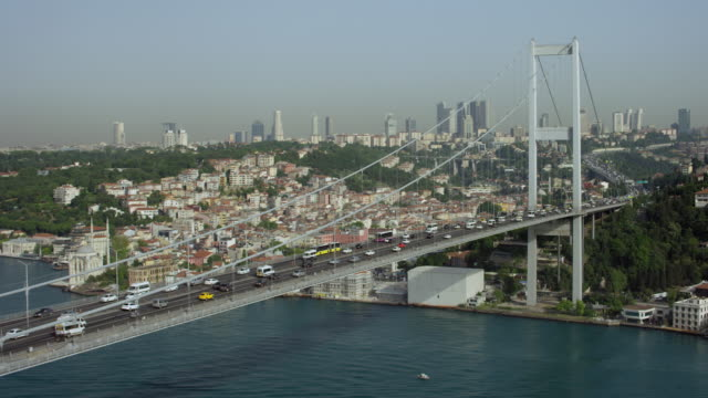 sweeping aerial shot of bosphorus bridge - july 15 martyrs' bridge stock videos & royalty-free footage