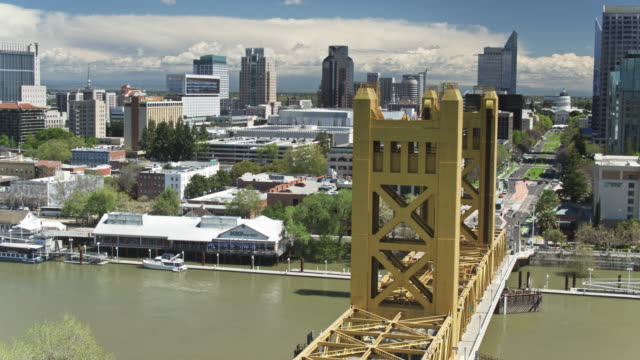 sweeping aerial shot of tower bridge and downtown sacramento - tower bridge stock videos & royalty-free footage