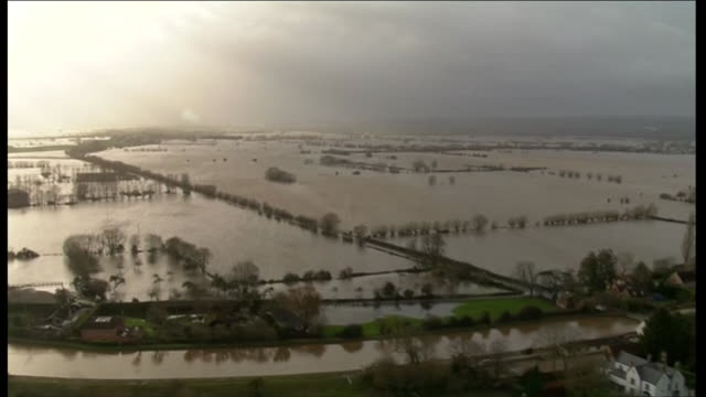 sweeping aerial shot over severe flooding on the somerset levels during uk floods crisis - somerset levels stock videos and b-roll footage