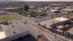 A Sweeping Drone Clip Looking Down On A Commuter Train In Salt Lake City