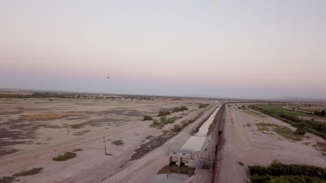 sweeping drone clip of the international border wall near socorro, texas and ciudad juarez, mexico - international border stock videos & royalty-free footage