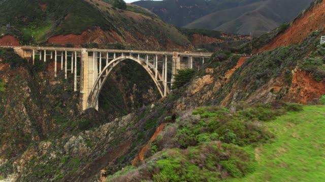 sweeping drone flight towards bixby creek bridge - bixby creek bridge stock videos & royalty-free footage