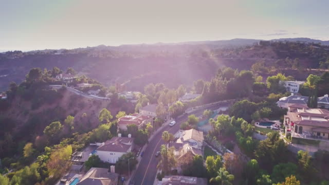 sweeping drone shot of beverly hills residential area - beverly hills stock videos & royalty-free footage