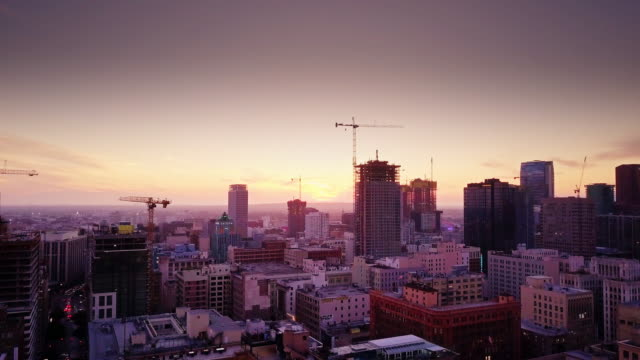 Sweeping Drone Shot of Buildings and Cranes in DTLA