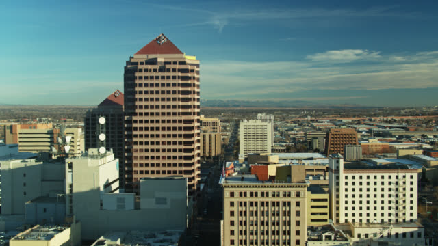 sweeping drone shot of downtown albuquerque on a sunny morning - albuquerque new mexico stock videos & royalty-free footage