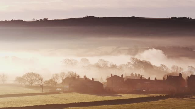 Sweeping Drone Shot of Oxenhope, W Yorkshire Covered in Morning Fog