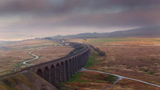 sweeping drone shot of the ribblehead viaduct at sunset - viaduct stock videos & royalty-free footage