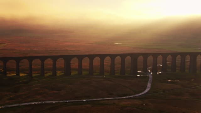sweeping drone shot of the ribblehead viaduct, north yorkshire - yorkshire england stock videos & royalty-free footage