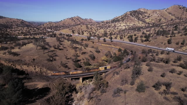 Sweeping Drone Shot Over Freight Train Entering Tehachapi Loop