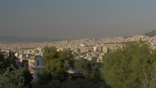 sweeping pan from athens national observatory to mount lycabettus to the acropolis from at sunset, athens, greece, europe - lycabettus hill stock videos & royalty-free footage