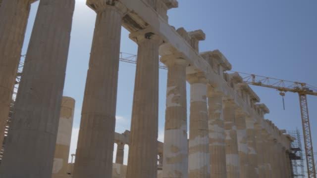 sweeping shot from the parthenon to erechtheion, the acropolis, unesco world heritage site, athens, greece, europe - the erechtheion stock videos & royalty-free footage