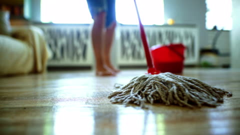 sweeping the floor with a mop. - cleaning stock videos & royalty-free footage