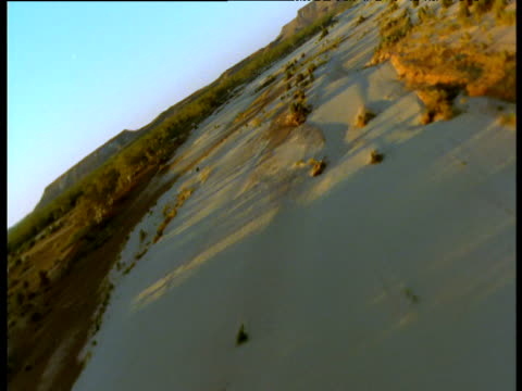 sweeping track over dry river bed in outback, northern territory, australia - curve stock videos & royalty-free footage