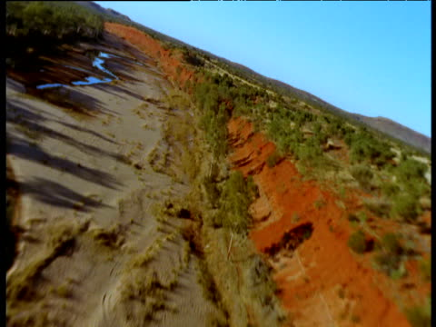 Sweeping track over drying Finke River bed in outback, Northern Territory, Australia