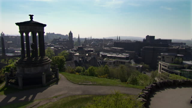 sweeping view of edinburgh cityscape from calton hill - edinburgh scotland stock videos & royalty-free footage