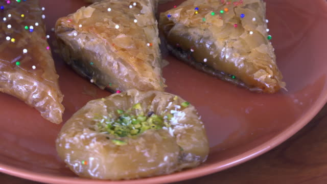 sweet food dessert: baklava pastries slowly turning on a display - pastry dough stock videos & royalty-free footage