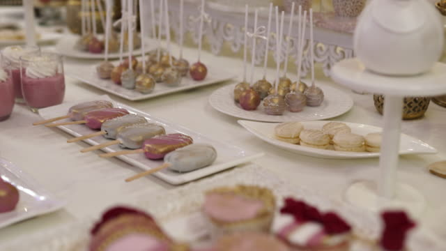 sweet food on dessert table for a wedding - sweet food stock videos & royalty-free footage