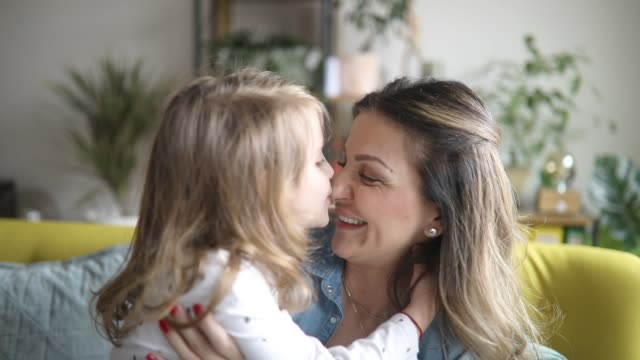 sweet little girl hugging mother and kissing her on the cheek - mother and daughter making out stock videos & royalty-free footage