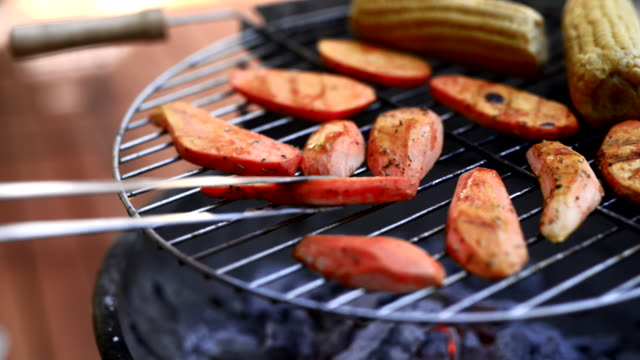 sweet potato on a open flame grill. - sweet potato stock videos & royalty-free footage
