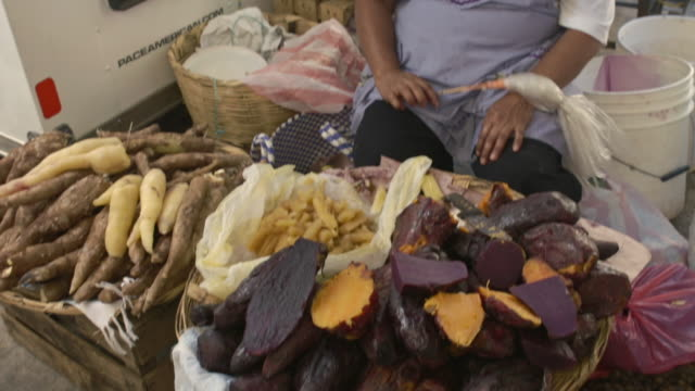 sweet potato or camote in a market - taco stock videos & royalty-free footage