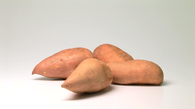 sweet potatoes - beta carotene stock videos and b-roll footage