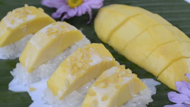 sweet sticky rice with mango thai dessert hd - mango stock videos and b-roll footage