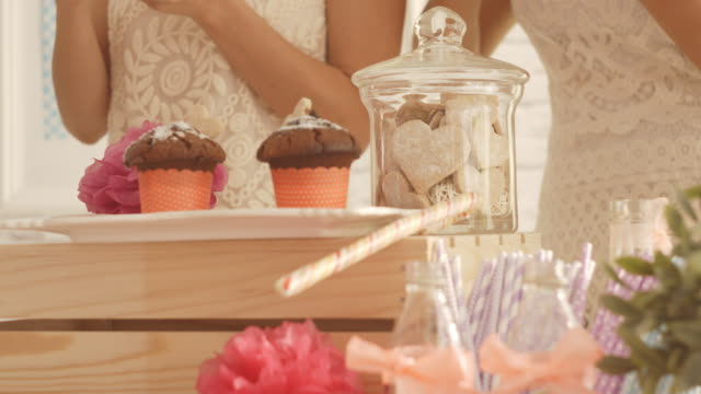 sweet table with food and drinks at baby shower party - baby shower video stock e b–roll